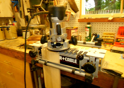 Cutting the dovetails with the Porter Cable 4212 jig.