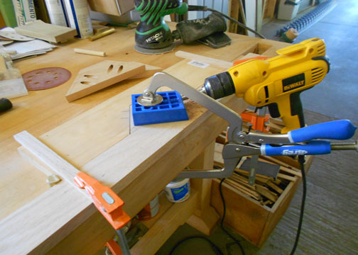 Drilling pocket holes showing my home made hold-down jig.