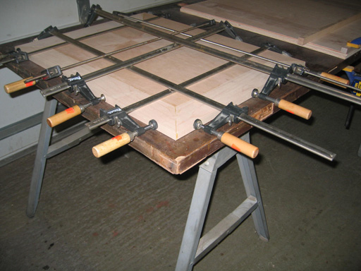 View of surrounding top pieces being clamped to top.