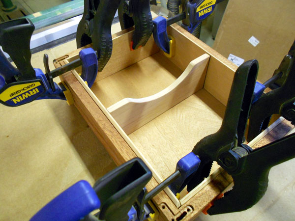 Another view of clamping in the cedar lining inside the box.