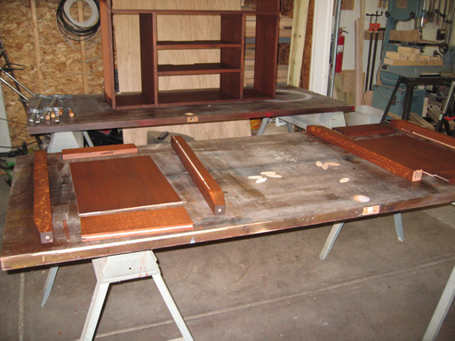 End panel pieces after staining and before assembly.