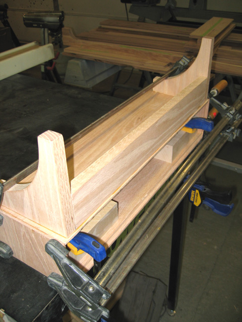 Clamping main drawer case to bracket assembly.