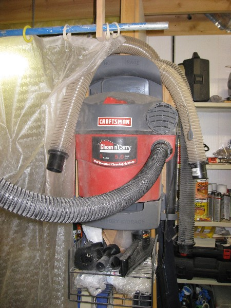 Wall hung Craftsman shop vac.