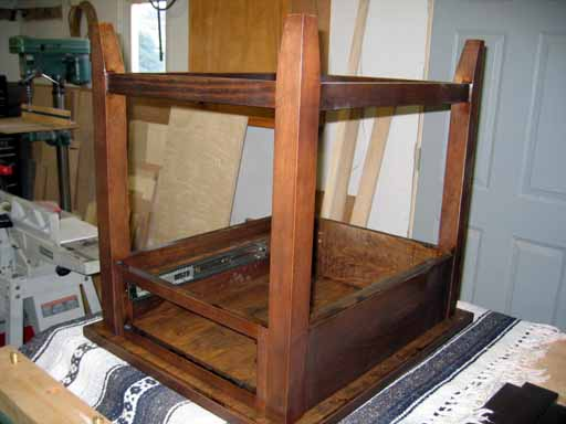 Inverted table after staining prior to mounting the corner braces.